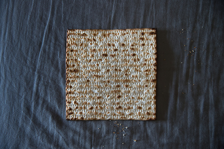 A &quot;Matza&quot;, an unleavened flatbread, which is used by Jewish believers instead of a regular, leavened bread, which is forbidden during the feast of Passover.<br /> The holiday of Passover commemorates the exodus of the Israelites from slavery in ancient Egypt; according to the biblical narrative, the Israelites left Egypt in such haste they could not wait for their bread dough to rise, and took with them Matza-like bread.