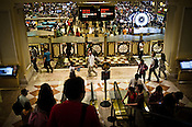 Macanese and other tourists go in and out of the casino floor of the Venetian Macau Resort Hotel in Macau, China.