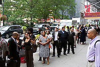 Job seekers line up for a job fair in midtown in New York on Thursday, September 15, 2011.  ( © Frances M. Roberts)