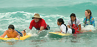 Saturday, August 23 2008.  Chip Hasley and his daughter Hasley, (13) help a group of children during the 22nd Annual Kids Day hosted by the Windansea Surf Club at La Jolla Shores.  Hasley is the son of Chuck Hasley, one of the original surfers who founded the club in 1963.