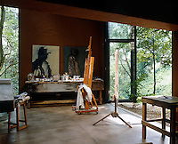 Vast metal and glass doors in Johann Slee's studio draw open up so the garden becomes part of the interior