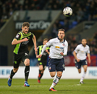 Bolton Wanderers' Adam Le Fondre vies for possession with Bury's Cameron Burgess<br /> <br /> Photographer Alex Dodd/CameraSport<br /> <br /> The EFL Sky Bet League One - Bolton Wanderers v Bury - Tuesday 18th April 2017 - Macron Stadium - Bolton<br /> <br /> World Copyright &copy; 2017 CameraSport. All rights reserved. 43 Linden Ave. Countesthorpe. Leicester. England. LE8 5PG - Tel: +44 (0) 116 277 4147 - admin@camerasport.com - www.camerasport.com