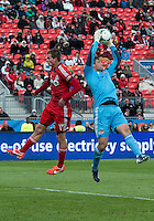 20 April 2013:Houston Dynamo goalkeeper Tally Hall #1 and Toronto FC forward Justin Braun #17 in action during the first half in an MLS game between the Houston Dynamo and Toronto FC at BMO Field in Toronto, Ontario Canada...