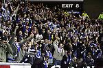 Rangers v St Johnstone....08.11.06   CIS Cup Quarter Final.Saints fans celebrates Steven Milne's opening goal..Picture by Graeme Hart..Copyright Perthshire Picture Agency.Tel: 01738 623350  Mobile: 07990 594431