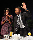 United States President Barack Obama acknowledges applause after speaking at the National Prayer Breakfast in Washington, DC, February 2, 2012. .Credit: Chris Kleponis / Pool via CNP