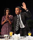 United States President Barack Obama acknowledges applause after speaking at the National Prayer Breakfast in Washington, DC, February 2, 2012. .Credit: Chris Kleponis / Pool via CNP