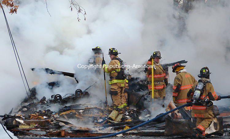 OXFORD, CT-26 February 2014-022614BF19-     A fire that started in a garage destroyed a house at 2 Scott Drive in Oxford on Wednesday. Fire departments from Oxford, Southbury, Beacon Falls and Seymour responded to the blaze at a home owned by Franklin B. Young Jr. and Susan L. Young. There were no injuries reported. The husband and wife who own the 3,000-square-foot building were home at the time of the fire. They escaped unharmed, along with their dog Smudge.  Bob Falcetti Republican-American