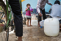 A child drinks water from the iJal station in Gorikathapalli, a remote village in Warangal, Telangana, India, on 22nd March 2015. Safe Water Network works with local communities that live beyond the water pipeline to establish sustainable and reliable water treatment stations within their villages to provide potable and safe water to the communities at a nominal cost. Photo by Suzanne Lee/Panos Pictures for Safe Water Network