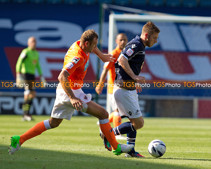 James Henry, Millwall FC tries to get inside Ian Evatt, Blackpool FC - Millwall vs Blackpool - NPower Championship Football at the New Den, London - 18/08/12 - MANDATORY CREDIT: Ray Lawrence/TGSPHOTO - Self billing applies where appropriate - 0845 094 6026 - contact@tgsphoto.co.uk - NO UNPAID USE.