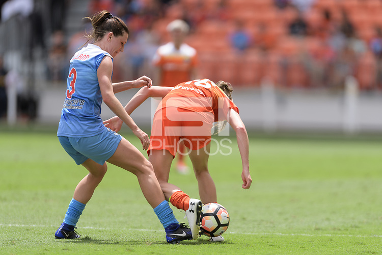 Houston, TX - Saturday April 15, 2017: Arin Gilliland and Janine Beckie battle for control of the ball during a regular season National Women's Soccer League (NWSL) match won by the Houston Dash 2-0 over the Chicago Red Stars at BBVA Compass Stadium.