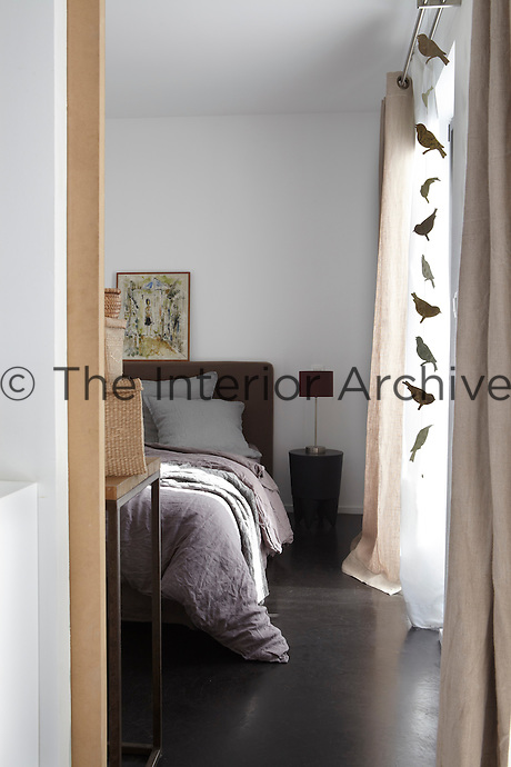 The emphasis is on natural linen in this simply furnished bedroom
