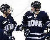 Casey Thrush (UNH - 19), Trevor van Riemsdyk (UNH - 6) - The Boston College Eagles and University of New Hampshire Wildcats tied 4-4 on Sunday, February 17, 2013, at Kelley Rink in Conte Forum in Chestnut Hill, Massachusetts.