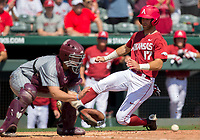 NWA Democrat-Gazette/JASON IVESTER<br /> Arkansas' Luke Bonfield slides past Mississippi State catcher Dustin Skelton Sunday, March 19, 2017, for a run at Baum Stadium in Fayetteville.