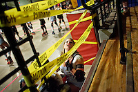 Etta Maims shouts to fans from the bench during a roller derby bout in Wilmington, Massachusetts. Roller derby is an American contact sport, popular with young women, which combines both athleticism and a satirical punk third-wave feminism aesthetic.