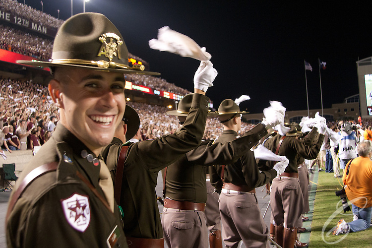 "Corps of Cadets seniors cheer on the Texas A&M football team against Oklahoma State University in 2007.  At each football game, a different group of senior cadets serve as ""Officers of the Day"" representing the rest of the university's 1800-member Corps of Cadets in the Kyle Field stands."