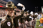 """Corps of Cadets seniors cheer on the Texas A&M football team against Oklahoma State University in 2007.  At each football game, a different group of senior cadets serve as """"Officers of the Day"""" representing the rest of the university's 1800-member Corps of Cadets in the Kyle Field stands."""