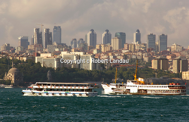 Ferry boats on the Golden Horn passing Istanbul's changing skyline, Turkey