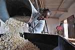 A corn mill in Nkholongo, Malawi, sponsored by the Livingstonia Synod of the Church of Central Africa Presbyterian. Proceeds from the operation of the mill support orphans and other vulnerable children in the community.