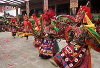 Masked dancers tame demons & negativity  at the Monlam Chenpo, Katok Dorjeden Monastery - Kham, (Tibet), Sichuan, China