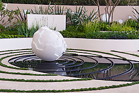 Meditation garden pond with concentric circles &amp; ornamental modern sculpture