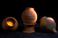 Harappan disposable drinking cups circa 2200-1400BC.  4,800 years ago, at the same time as the early civilizations of Mesopotamia and Egypt, great cities arose along the flood plains of the Indus and Saraswati (Ghaggar-Hakra) rivers.  Developments at Harappa have pushed the dates back 200 years for this civilization, proving once and for all, that this civilization was not just an offshoot of Mesopotamia..They were a highly organized and very successful civilization.  They built some of the world's first planned cities, created one of the world's first written languages and thrived in an area twice as large as Egypt or Mesopotamia for 900 years (1500 settlements spread over 280,000 square miles on the subcontinent)..There are three major communities--Harappa, Mohenjo Daro, and Dholavira. The town of Harappa flourished during this period because of it's location at the convergence of several trade routes that spanned a 1040 KM swath from the northern mountains to the coast.