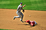 28 May 2011: San Diego Padres second baseman Logan Forsythe turns a double play on a sliding Roger Bernadina to end the game against the Washington Nationals at Nationals Park in Washington, District of Columbia. The Padres defeated the Nationals 2-1 to even up their 3-game series. Mandatory Credit: Ed Wolfstein Photo