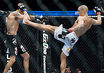 Dustin Poirer, white trunks, tries to kick Pablo Garza at Saturday's UFC on Fox event at the Honda Center.