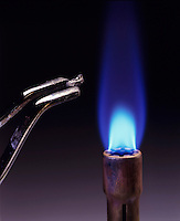 CALCIUM FLAME TEST<br /> Near flame<br /> (1 of 3 - Variations Available)<br /> Calcium metal is held near Bunsen burner.