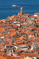View over the roof tops with sea in the distance & Town Hall in forground. Piran , Slovenia
