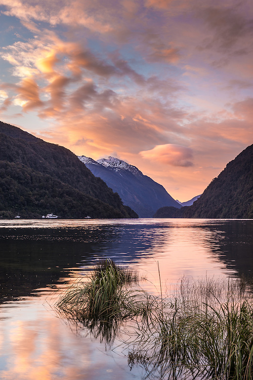 Sunset clouds reflected in Doubtful Sound.  Fiordland National Park, South Island, New Zealand - stock photo, canvas, fine art print