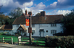 The Village Pub. Scarlett or Scarlet Arms. Walliswood, Surrey, England. Pub sign spelling is different from that painted on exterior wall of public house.