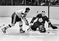 Seals #7 Billy Harris or EarlIngarfield against Toronto Maple Leafs goalie #30...(1970 photo/Ron Riesterer)