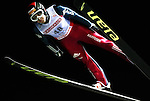 Simon Ammann of Switzerland soars through the night skies during the FIS World Cup Ski Jumping in Sapporo, northern Japan in March, 2007.