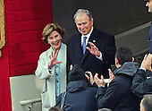 Former United States President George W. Bush and his wife, Laura, arrive for the swearing-in ceremony as Donald J. Trump is sworn-in as the 45th President of the United States on the West Front of the US Capitol on Friday, January 20, 2017.<br /> Credit: Ron Sachs / CNP<br /> (RESTRICTION: NO New York or New Jersey Newspapers or newspapers within a 75 mile radius of New York City)
