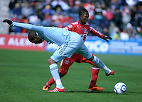 Chicago Fire midfielder Patrick Nyarko (14) maneuvers around Sporting KC defender Craig Rocastle (4).  The Chicago Fire defeated Sporting KC 3-2 at Toyota Park in Bridgeview, IL on March 27, 2011.
