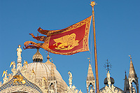 Venician flag flying over Saint Marks Basilica - Venice