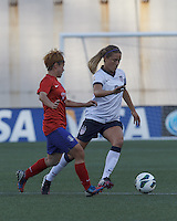 USWNT defender Kristie Mewis (8) dribbles as Korea Republic midfielder Park Heeyoung (17) defends. In an international friendly, the U.S. Women's National Team (USWNT) (white/blue) defeated Korea Republic (South Korea) (red/blue), 4-1, at Gillette Stadium on June 15, 2013.