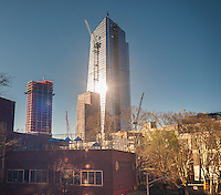 Late afternoon sun reflects off of the under construction 10 Hudson Yards in New York on Tuesday, April 5, 2016. The building will house Coach, L'Oreal USA and other firms. (© Richard B. Levine)