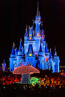 Alice in Wonderland, Disney's Electrical Parade (with Cinderella Castle in back), Magic Kingdom, Walt Disney World, Orlando, Florida USA
