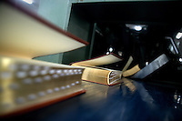 "Newly-finished Bibles come out of a book covering machine in the Amity Printing Company's new printing facility in Nanjing, China....On May 18, 2008, the Amity Printing Company in Nanjing, Jiangsu Province, China, inaugurated its new printing facility in southern Nanjing.  The facility doubles the printing capacity of the company, now up to 12 million Bibles produced in a year, making Amity Printing Company the largest producer of Bibles in the world.  The company, in cooperation with the international organization the United Bible Societies, produces Bibles for both domestic Chinese use and international distribution.  The company's Bibles are printed in Chinese and many other languages.  Within China, the Bibles are distributed both to registered and unregistered Christians who worship in illegal ""house churches."""