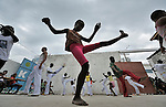 A girl practices capoeira on January 24 in a camp for homeless families in the Belair section of Port-au-Prince. The program, run by Viva Rio, a Brazilian nongovernmental organization, is designed to help children affected by the quake recover their emotional well-being.