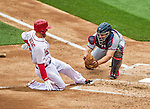 4 April 2014: Atlanta Braves catcher Evan Gattis gets a sliding Adam LaRoche out at the plate in the 4th inning of the Washington Nationals Home Opening Game at Nationals Park in Washington, DC. The Braves edged out the Nationals 2-1 in their first meeting of the 2014 MLB season. Mandatory Credit: Ed Wolfstein Photo *** RAW (NEF) Image File Available ***