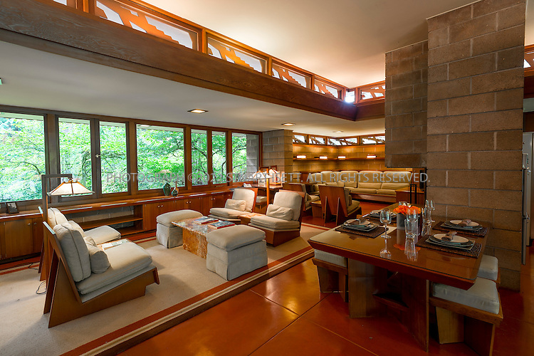 """10/9/2012--Sammamish, WA, USA..VIEW: Interior with dining table, living room area...Architect Frank Lloyd Wright planned his """"Usonian"""" homes to be affordable for middle-class families. The 1,9500 square foot Brandes home is for sale in Sammamish, Washington (30 minutes from Seattle) at $1.39 million. It features three bedrooms, two bathrooms and a small, separate office/study space...The home was built in 1952, and has redwood trim and Wright's original furniture and some garden sculptures by Wright. It's one of only three Frank Lloyd Wright homes near Seattle...©2012 Stuart Isett. All rights reserved."""
