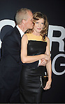 "actress Rene Russo and husband Dan Gilroy attends the World Premiere of ""The Bourne Legacy"" on July 30, 2012 at The Ziegfeld Theatre in New York City. The movie stars Jeremy Renner, Rachel Weisz, Edward Norton, Stacy Keach, Dennis Boutsikaris and Oscar Isaac."