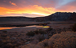 California, east central, Lee Vining. A colorful sunrise over the inlet to Grant Lake on the June Lake Loop Road in autumn.