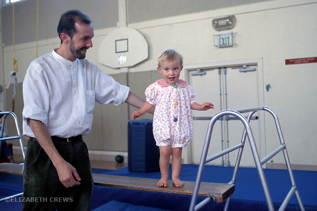 Albany  CA  Father delighted with daughter, two years old, as she experiments with balancing at gymnastics program for preschoolers  MR