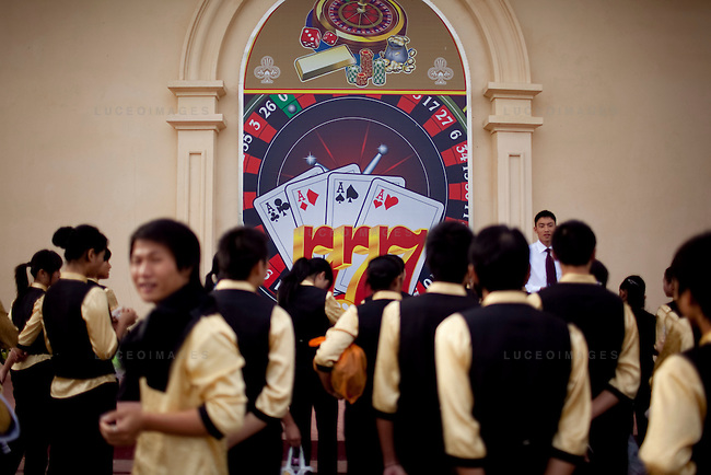 A new casino, which is partially open, is being constructed on the Laos side of the the Mekong River opposite of Sop Ruak, Thailand. Casino employees receive instructions for the outside the casino. The land was rented from the government and displaced a Laos village. Photo taken on Thursday, December 10, 2009. Kevin German / Luceo Images