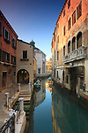 A view around sunset of Rio della Madallena, a canal of Venice, with the church of La Maddalena in the background.