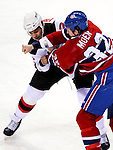 9 January 2010: New Jersey Devils' defenseman Mark Fraser gets into a first period fight with Montreal Canadiens left wing forward Travis Moen at the Bell Centre in Montreal, Quebec, Canada. The Devils edged out the Canadiens 2-1 in overtime. Mandatory Credit: Ed Wolfstein Photo
