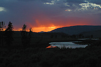 Smoke from forest fires often enhance the sunsets in July and August in Yellowstone.  Lamar Valley.